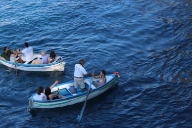 These boats take you inside the Blue Grotto